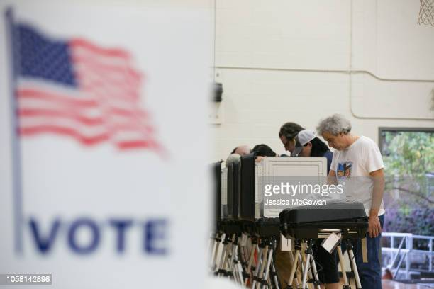Voters cast their ballots at a polling station set up at Grady High School for the midterm elections on November 6 2018 in Atlanta Georgia Georgia...