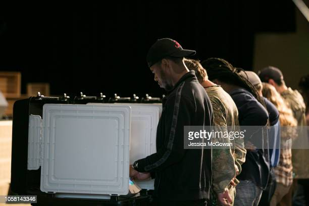 Voters cast their ballots at a polling station set up at Noonday Baptist Church for the midterm elections on November 6 2018 in Marietta Georgia...