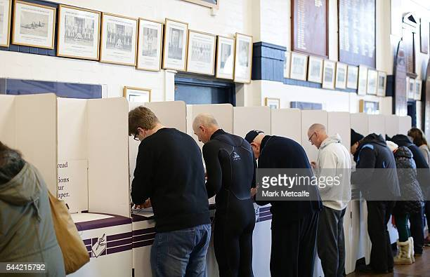 Voters cast their ballots at Bondi Surf Bathers' Life Saving Club in the electorate of Wentworth on July 2 2016 in Sydney Australia Voters head to...