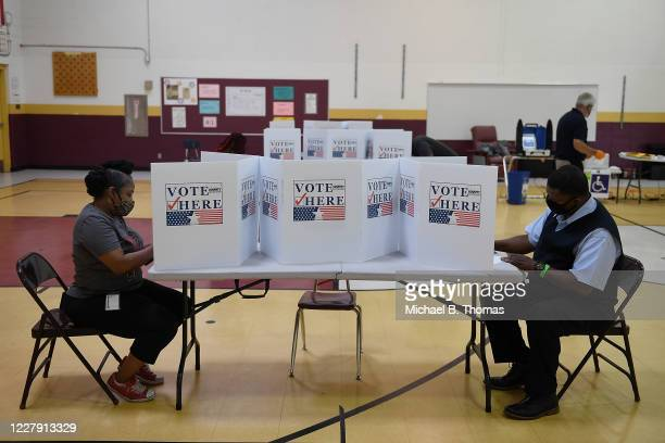 Voters cast their ballots at Keevan Elementary School August 4, 2020 in North St. Louis, Missouri. Primary voters in Arizona, Kansas, Michigan,...