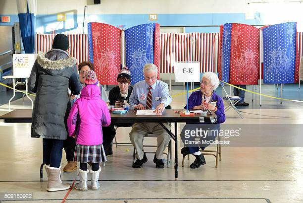 Voters cast their ballots at the Bishop Leo E O'Neil Youth Center February 9 2016 in Manchester New Hampshire New Hampshire voters finally go to the...