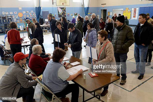 Voters cast their ballots at the Bishop Leo E O'Neil Youth Center February 9 2016 in Manchester New Hampshire Today New Hampshire voters go to the...