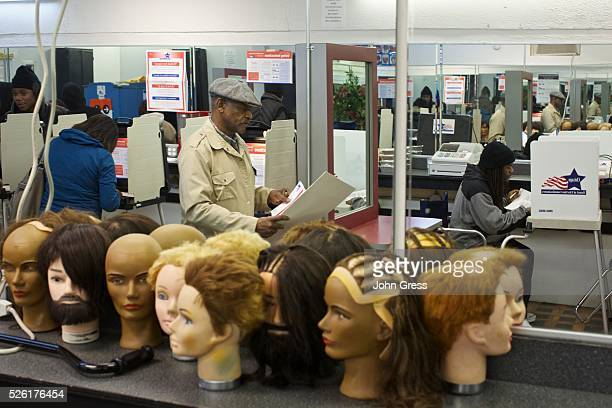 Voters cast their ballots at the Gordies Foundation Barber School during the U.S. Presidential election at Sam's Auto Sales in Chicago, November 6,...