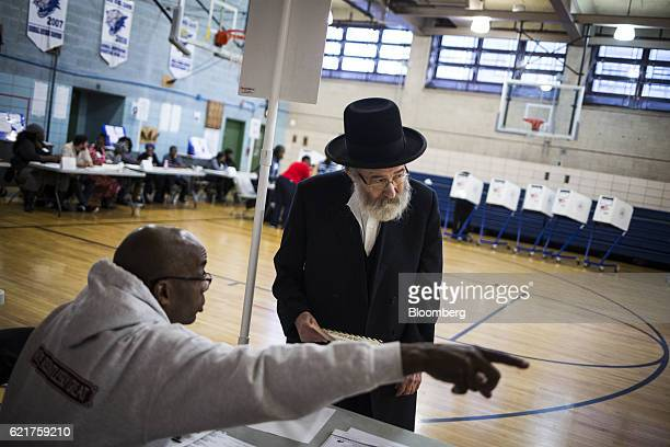 Voters cast their ballots at the Juan Morel Campos Secondary School polling location in Brooklyn New York US on Tuesday Nov 8 2016 The Justice...