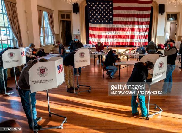 Voters cast their ballots at the old Stone School, used as a polling station, on election day in Hillsboro, Virginia on November 3, 2020. - Polling...