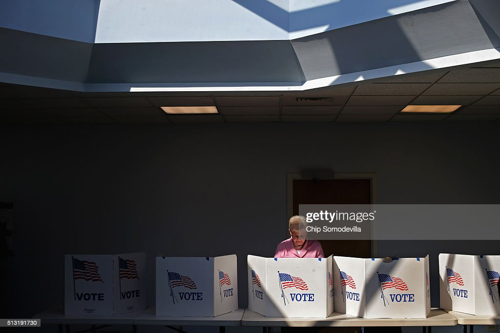 Voters cast their ballots at the polling place at Fairfax Circle Baptist Church during Super Tuesday voting March 1, 2016 in Fairfax, United States. Officials are expecting a record turn out of voters in Virginia, one of a dozen states holding presidential primaries or caucuses.