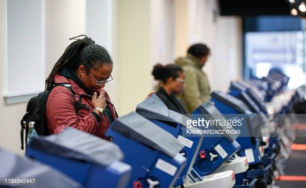 Voters cast their ballots at the polling place in downtown Chicago Illinois on April 2 2019 Chicago residents went to the polls in a runoff election...
