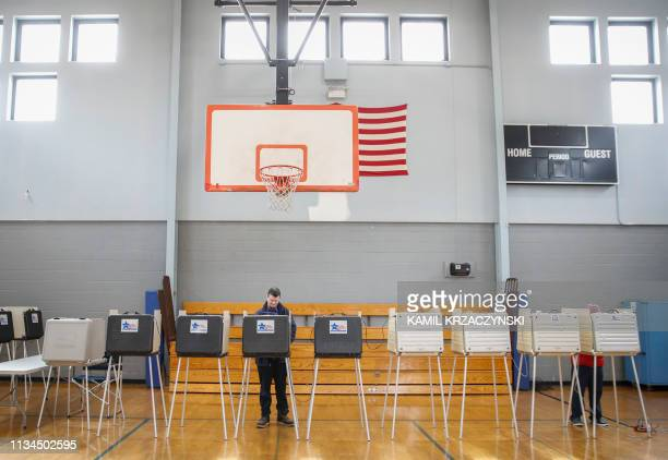 Voters cast their ballots at the polling place in the Father Thomas A Bernas Parish Center in Chicago Illinois on April 2 2019 Chicago residents went...