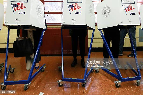 Voters cast their ballots at voting booths at PS198M The Straus School on November 8 2016 in New York City New York Americans across the nation are...