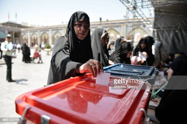 Voters cast their ballots during Iran's 12th presidential election at Shah Abdol Azim mosque in Tehran Iran on May 19 2017