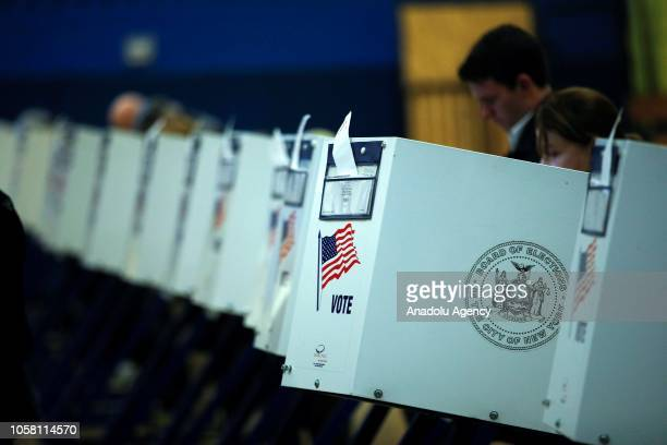 Voters cast their ballots during the midterm election at the High School Art and Design polling station in Manhattan, New York, United States on...