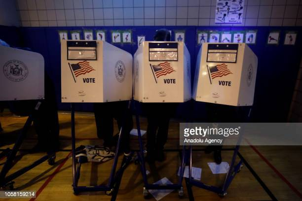 Voters cast their ballots during the midterm election during the midterm election at the Tribeca Independence Primary School polling station in...