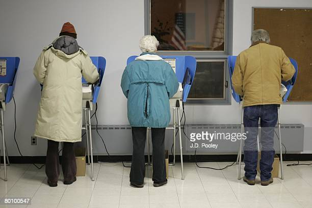 Voters cast their ballots early March 4 2008 in Bowling Green Ohio Polls show Democratic presidential hopefuls Sen Hillary Clinton and Sen Barack...