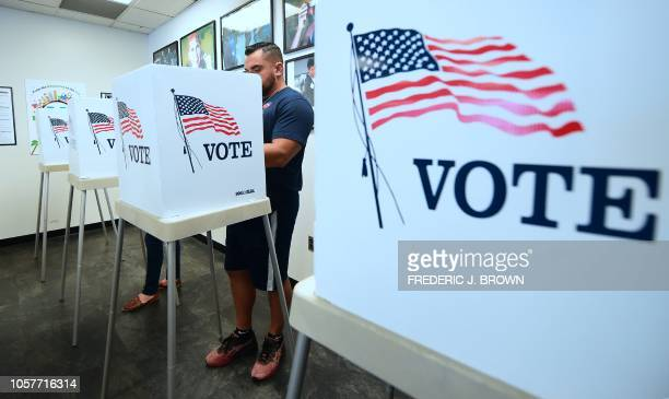 Voters cast their ballots for Early Voting at the Los Angeles County Registrar's Office in Norwalk, California on November 5 a day ahead the November...