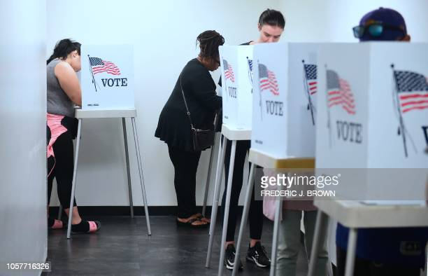 Voters cast their ballots for Early Voting at the Los Angeles County Registrar's Office in Norwalk California on November 5 a day ahead the November...