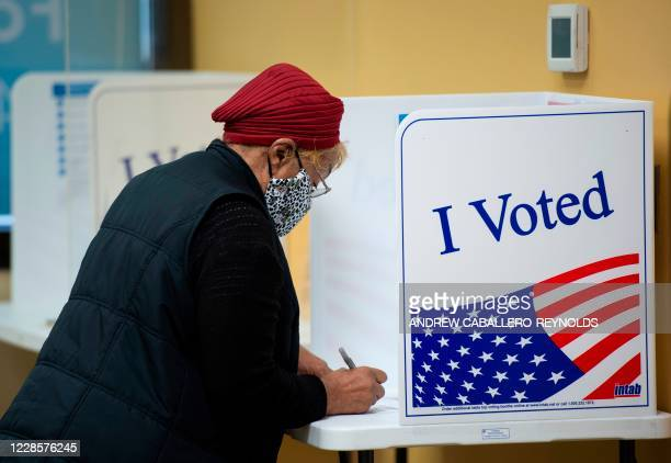 Voters cast their ballots for the 2020 election at an early inperson voting location in Arlington Virginia on September 18 2020
