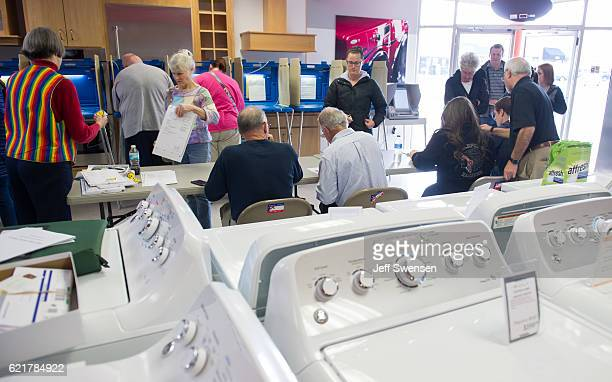 Voters cast their ballots in a polling location inside Mike's TV and Appliance November 8 2016 in State College Pennsylvania in the center of the...