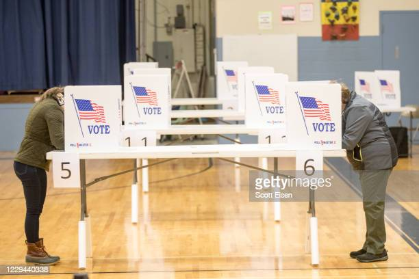 Voters cast their ballots in a socially distant manner on November 3, 2020 in Hermon, Maine. After a record-breaking early voting turnout, Americans...