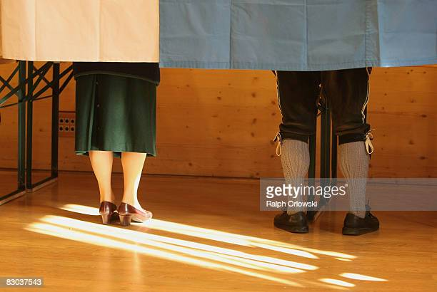 Voters cast their ballots in Bavarian state parliamentary elections on September 28 2008 in Gaissach near Bad Toelz Germany Preelection polls show...