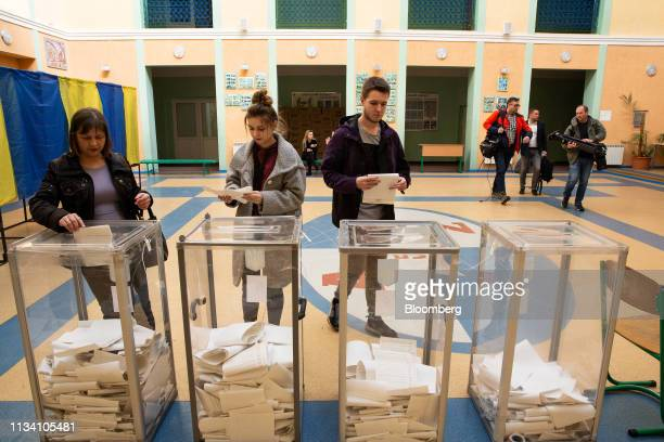 Voters cast their ballots in boxes at a polling station in Kiev Ukraine on Sunday March 31 2019 Ukrainians will choose between a field of almost 40...