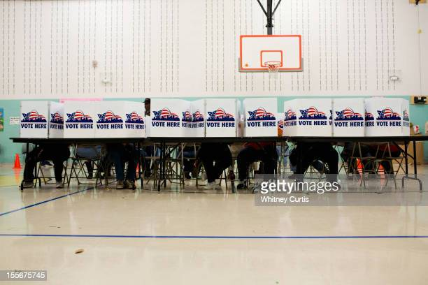 Voters cast their ballots in the general election November 6 2012 at Earl Nance Sr Elementary School in St Louis Missouri As Americans go to vote US...