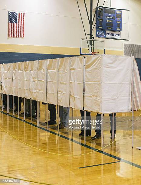 Voters cast their ballots in the Maine state midterm elections on at the Falmouth High School in Falmouth ME on Tuesday November 4 2014