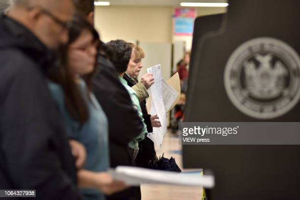Voters cast their ballots in the midterm election at PS 69 on November 6 2018 in the Jackson Heights neighborhood of the Queens borough of New York...