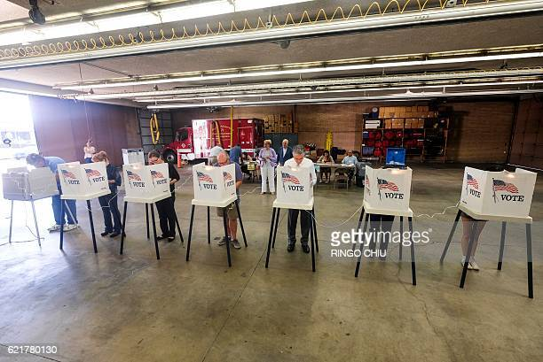 Voters cast their ballots in the US presidential election at a fire station in Alhambra California on November 8 2016 / AFP / RINGO CHIU