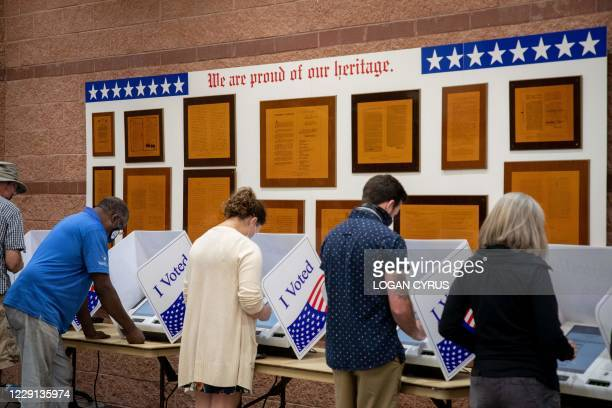 Voters cast their ballots in the voting booths at the early vote location at the Charleston Coliseum and Convention Center in North Charleston, South...