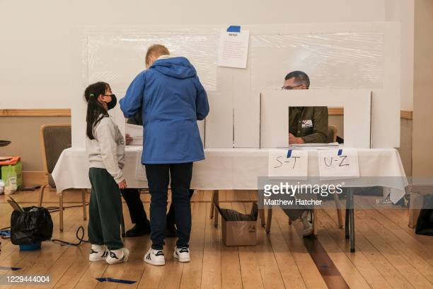 Voters cast their ballots on Election Day at a polling station at the Congregation Aguda Achim in Bexley on November 3, 2020 in Columbus, Ohio. After...
