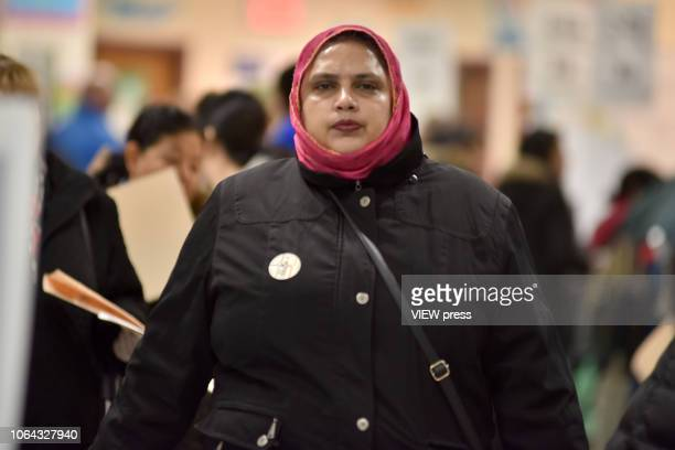 Voters cast their ballots on Election Day at PS 69 November 06 2018 in the Jackson Heights neighborhood of the Queens borough of New York City