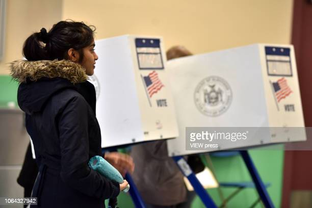 Voters cast their ballots on Election Day at PS 69 on November 06 2018 in the Jackson Heights neighborhood of the Queens borough of New York City