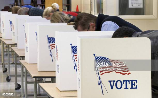 Voters cast their ballots on Election Day November 04 at Centreville High School in Clifton, Virginia. Americans crowded polling stations Tuesday to...