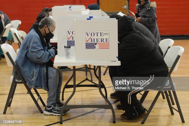 Voters cast their ballots on November 3, 2020 at Jennings Senior High School in St Louis, Missouri. After a record-breaking early voting turnout,...