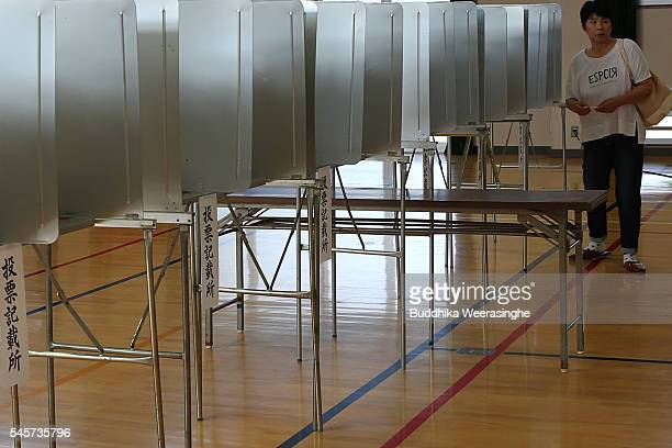 Voters cast their ballots to vote for parliament's upper house election at a polling station on July 10 2016 in Himeji Japan Japan went to vote...