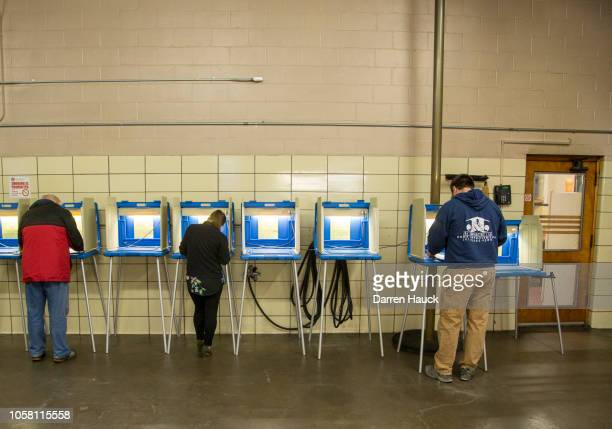 Voters cast their midterm ballots at the District 5 Ward 83 firehouse on November 6 2018 in Milwaukee Wisconsin Voters are turning out in historic...