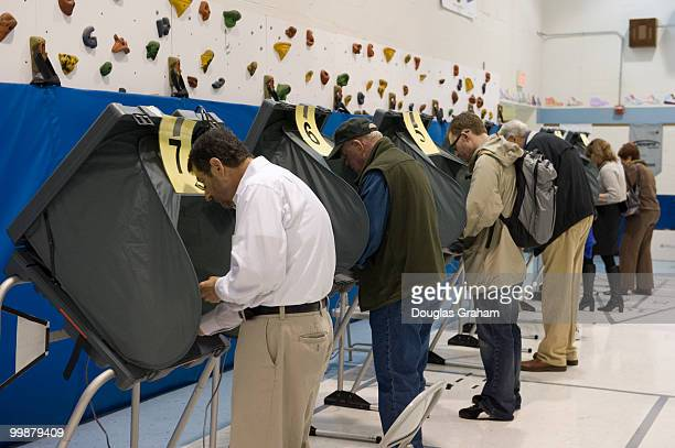 Voters cast their votes on November 4th 2008 at Lyles Crouch School in Alexandria Virginia He was accompanied by his wife Lisa Collis