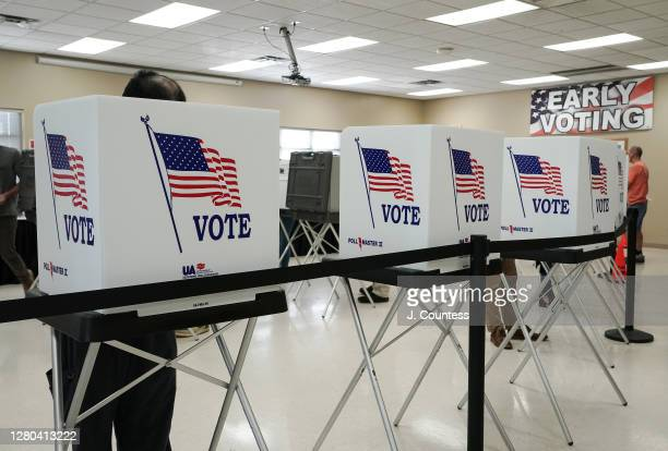 Voters cast their votes on the second day of early voting at the Hamilton County Election Commission on October 15, 2020 in Chattanooga, Tennessee....