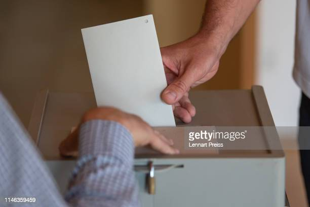 A voters casts his ballot in European parliamentary elections on May 26 2019 in Neustadt an der Donau Germany Today is the last day voters across the...