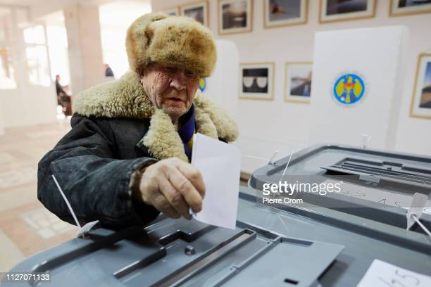 A voters casts their ballot during the parliamentary elections on February 24 2019 in Chisinau Moldova