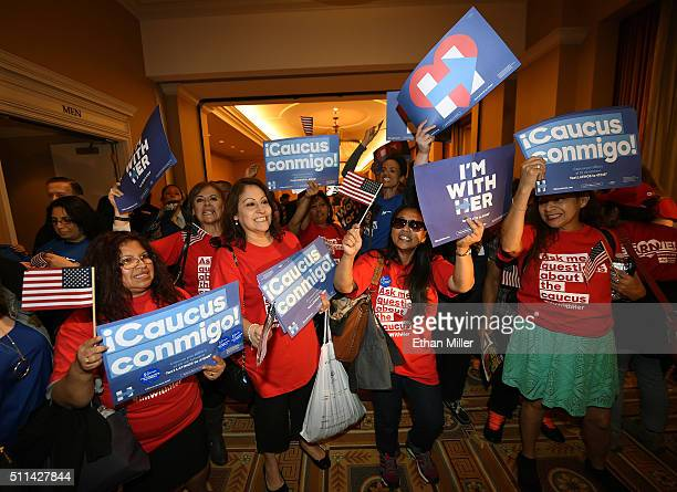 Voters chant as they wait in line to get into a Democratic caucus at Caesars Palace on February 20 2016 in Las Vegas Nevada Nevada voters are...