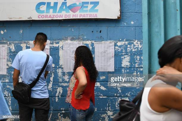 PETARE CARACAS MIRANDA VENEZUELA Voters check a registration list while waiting for their turn to vote at a polling station The presidential...