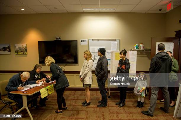 Voters check in before casting their midterm ballots on November 6, 2018 in Wauwatosa, Wisconsin. Voters are turning out in historic numbers to cast...
