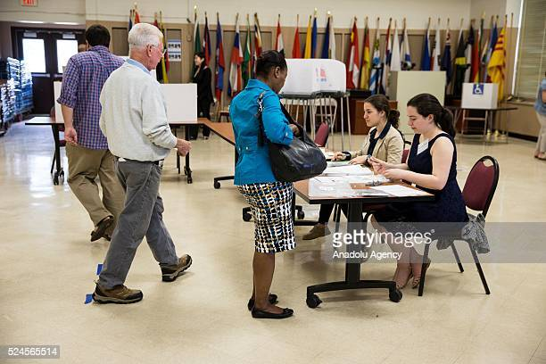 Voters check in with poll workers at Rocking Horse Road Center so they can cast their votes in the 2016 Maryland Primary Elections in Rockville Md...