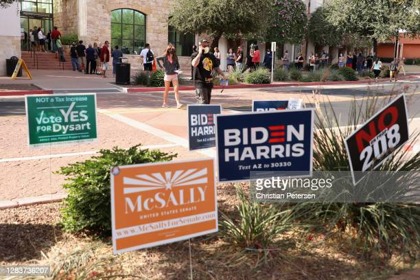 Voters cross the street after voting at the Surprise Court House polling location on November 03, 2020 in Surprise, Arizona. After a record-breaking...
