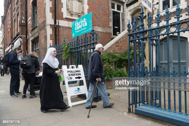 Voters enter a polling station in Brick Lane to vote in the General Election in London United Kingdom on June 08 2017