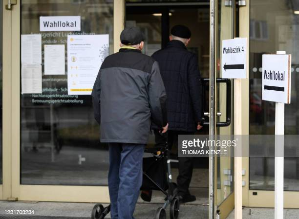 Voters enter a polling station in Ludwigsburg, southern Germany, to cast their ballots for state elections in the southern German federal state of...