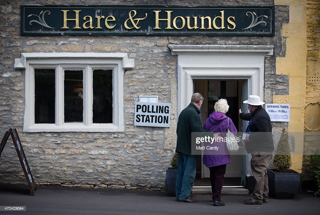 Voters enter a polling station located in a public house in Corsham on May 7, 2015 in Wiltshire, England. The United Kingdom has gone to the polls to vote for a new government in one of the most closely fought General Elections in recent history. With the result too close to call it is anticipated that there will be no overall clear majority winner and a coalition government will have to be formed once again.