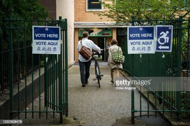 Voters enter a polling station on New York state's primary election day September 13 2018 in the Brooklyn borough of New York City Voters are set to...