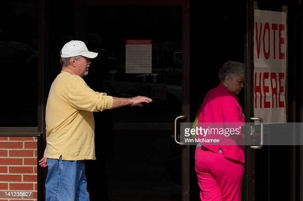 Voters enter the First Baptist Church Pelham Annex to cast their ballots in the Republican Presidential Primary March 13, 2012 in Pelham, Alabama....